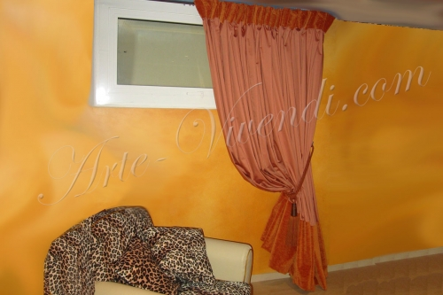 Rideau volumineuse coupe vertical velours en tete et en bas couleurs rouille et orange